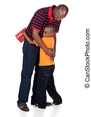 Father and son - Cute african boy wearing a bright orange...