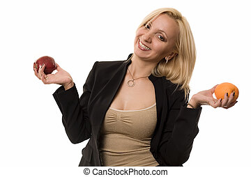 Comparing apples and oranges - Attractive blond woman with...