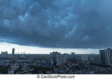 Rain clouds over Bangkok cityscape