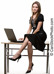 Woman sitting on desk - Full body of a young brunette...