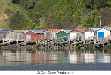 Akaroa Harbour Scenes - boatsheds at Duvauchelle - Scenes or...