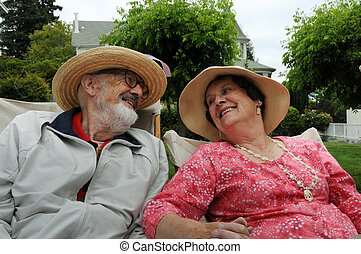 elderly couple - looking at each other lovingly