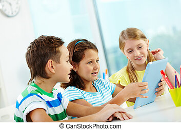 Modern schoolwork - Modern pupils doing their homework with...