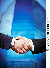 Trust - Vertical image of entrepreneurs concluding a deal...