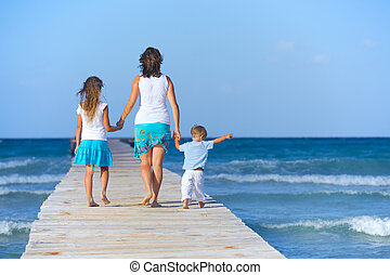 Family on wooden jetty