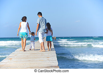 Family on wooden jetty.