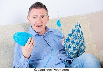 Man knitting