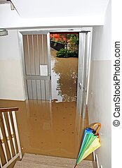 entrance of a House fully flooded during the flooding of the...