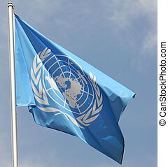 blue flag of the UN United Nations Organisation that move in...