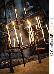 gothic candles - candles burning in a dark gothic building