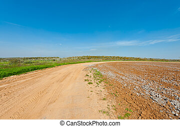 Plowed Fields - Dirt Road between Plowed Fields in Israel,...