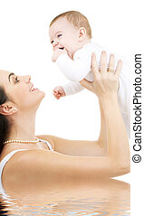 baby and mama - picture of happy mother with baby in water