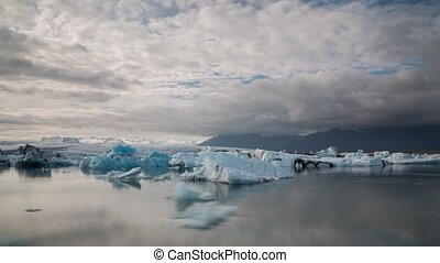 blue icebergs floating - Time lapse of blue icebergs...