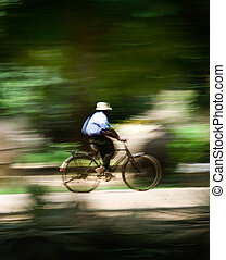 Man riding on a bicycle - motion blur