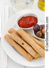 bread stick with sauce and olives