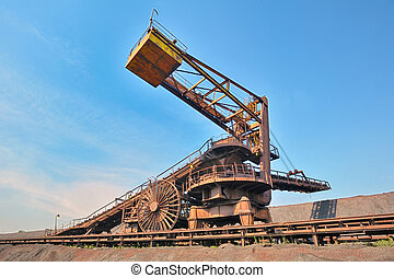 coal loading conveyor belt piles coal inside of plant
