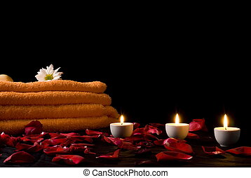 Spa Things Background - candles and flowers before towel at...