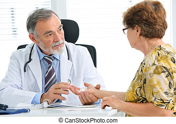 Medical exam - Physician examines the injured hand of the...