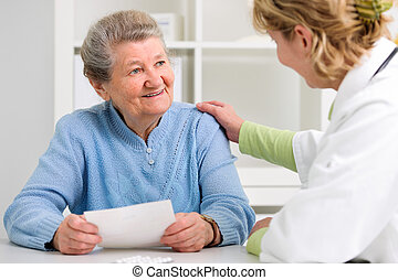 doctor and patient - doctor explaining diagnosis to her...