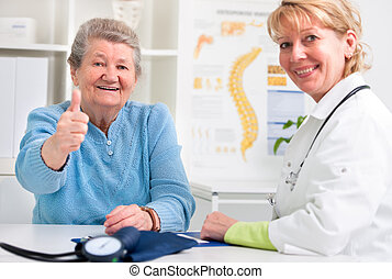Doctor and patient - Happy senior patient and doctor at the...