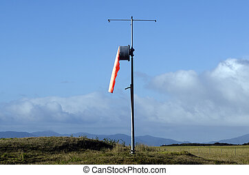 Windsock - Airport windsock on a pole, show no wind.