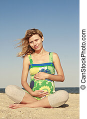 pregnant woman on the beach - a pregnant woman on the beach