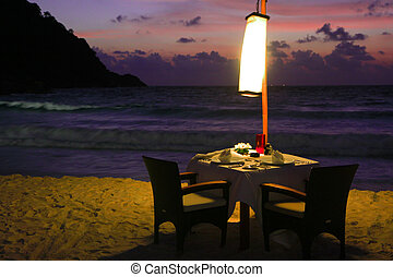 Dining table by the beach - Dining table in the evening,...