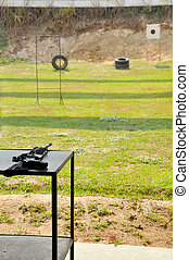M4A1 carbine rifle on a table in the yard shooting.