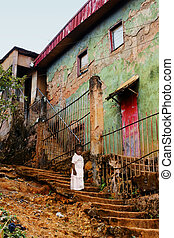 Litte African girl near old building