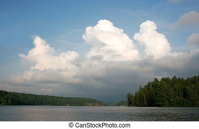 charlton lake ontario - cumulous clouds rising over...