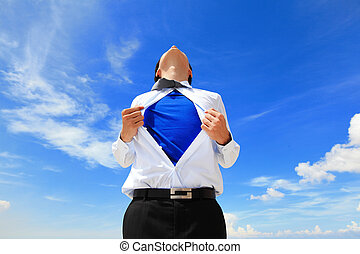 Business man showing superhero suit - Business man pulling...
