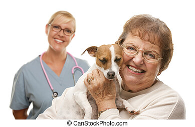 Happy Senior Woman with Dog and Veterinarian - Happy Senior...