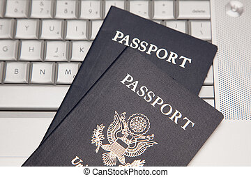 Passports on Laptop Keyboard - Abstract of Two Passports on...
