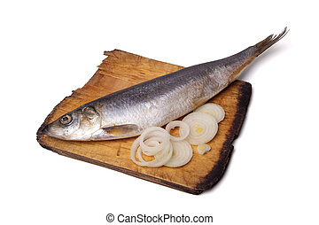 Herring with onion rings on old wooden cutting board