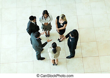 overhead view of business meeting - overhead view of people...