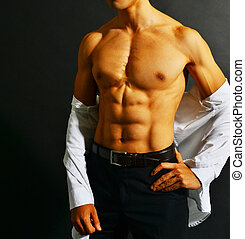 Muscular asian businessman