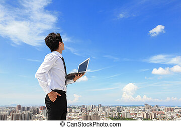 business man with laptop and look sky and cloud - Young...
