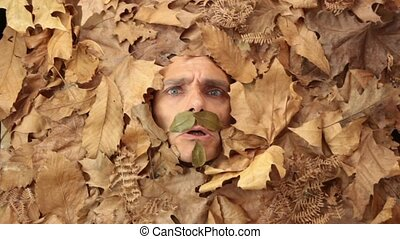 Mister angy autumn - funny angry man under falling leaves,...