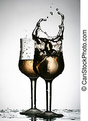wine splash in glass isolated on white background