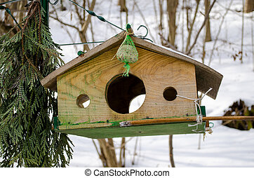 wooden bird feeder with three holes - nailed wooden bird...