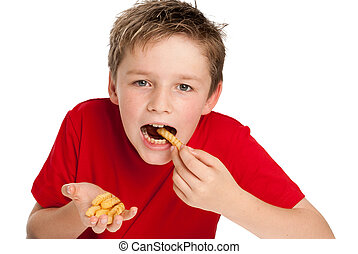 Handsome Young Boy Eating Fries - Good looking young boy...