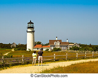 Couple Looking at a Cape Cod Lighthouse