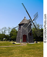 Woman Looks at Eastham Windmill in Cape Cod