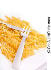 Dried Pasta - Dry pasta on a white Plate