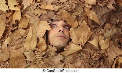 autumnal disease - sneezing man under falling leaves,...