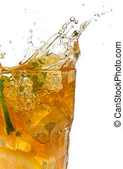 Glass of ice tea with ice-cubes on white background
