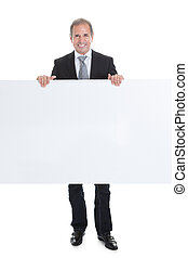 Happy Business Man Holding Blank Placard - Portrait Of Happy...