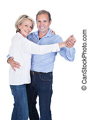 Portrait Of Mature Couple Dancing - Happy Mature Couple...