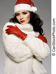 santa girl - beautiful brunette girl Santa posing on grey...