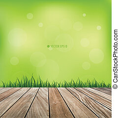 Natural background. Fresh spring green grass and wood floor....